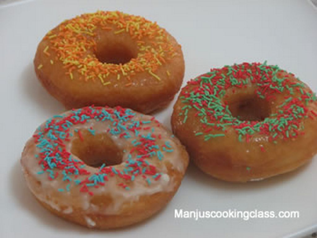 Doughnuts iced with sprinkles